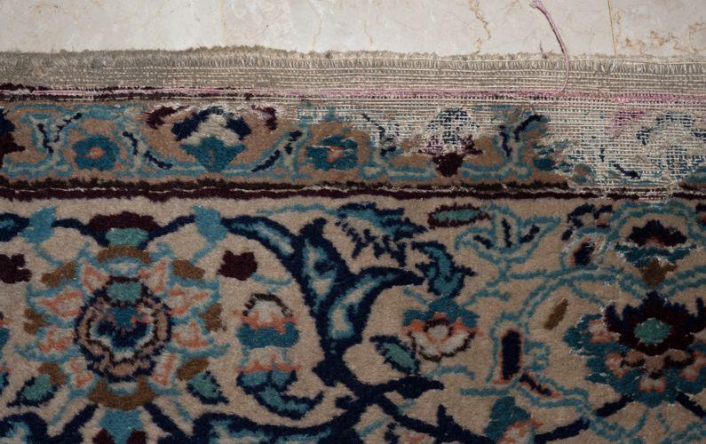 Moth damage to a Nain rug